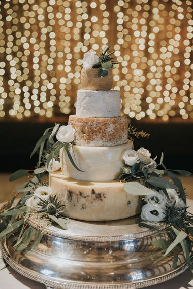 Cheese Tower Alternative Wedding Cake with Fairy Light Backdrop
