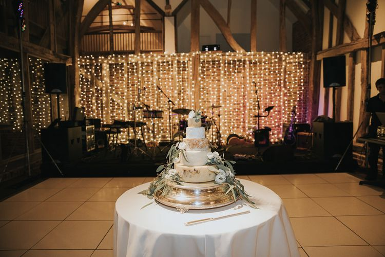 Cheese Tower Wedding Cake in Front of Fairy Lights