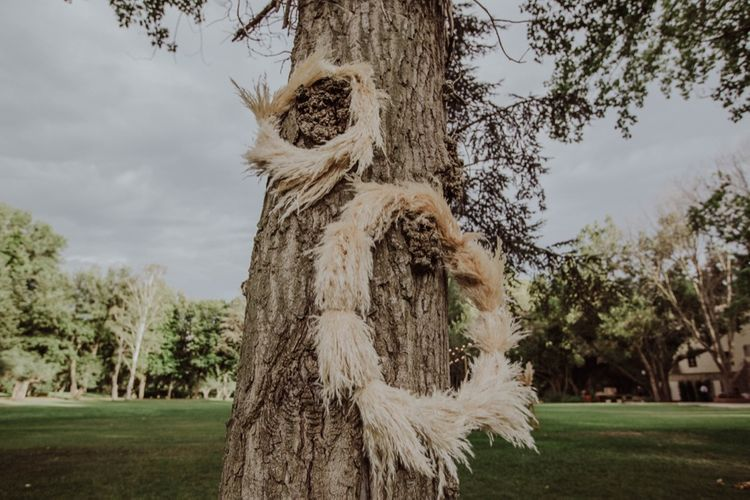 Pampas Grass Hoops Wedding Decor | Outdoor Woodland Wedding at Sa Farinera de Sant LLuis Wedding Venue, Catalan Empordà, Spain | Planned & Styled by Mille Papillons | HUMà06 Photography | HUMà06 Photography