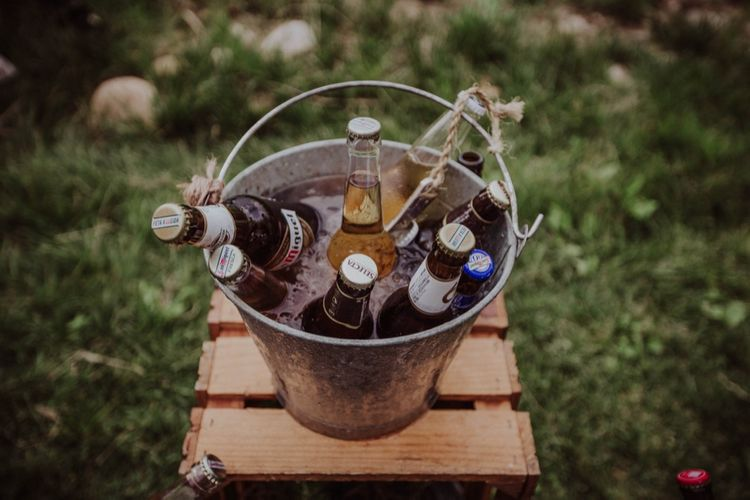 Bottles of Beer in a Bucket | Outdoor Woodland Wedding at Sa Farinera de Sant LLuis Wedding Venue, Catalan Empordà, Spain | Planned & Styled by Mille Papillons | HUMà06 Photography | HUMà06 Photography
