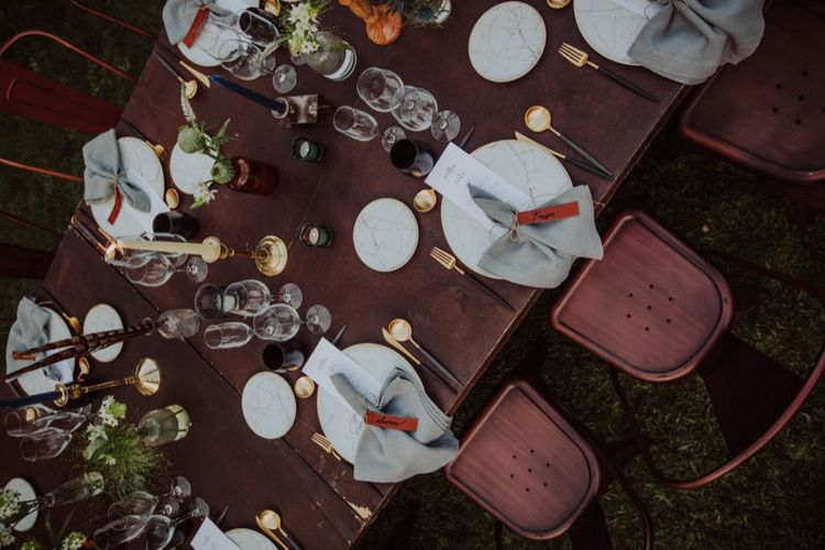 Elegant Place Setting with Leather Name Place Card, Gold Cutlery & Marble Tableware | Outdoor Woodland Wedding at Sa Farinera de Sant LLuis Wedding Venue, Catalan Empordà, Spain | Planned & Styled by Mille Papillons | HUMà06 Photography | HUMà06 Photography
