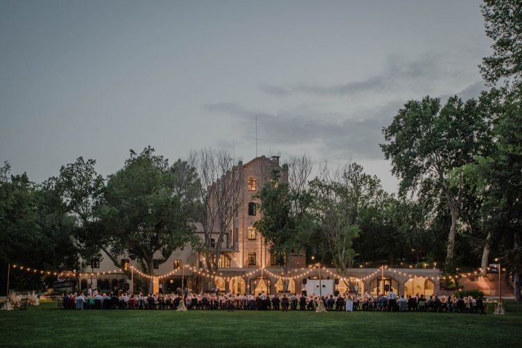 Outdoor Wedding Reception with Festoon Lights | Woodland Wedding Ceremony at Sa Farinera de Sant LLuis Wedding Venue, Catalan Empordà, Spain | Planned & Styled by Mille Papillons | HUMà06 Photography | HUMà06 Photography