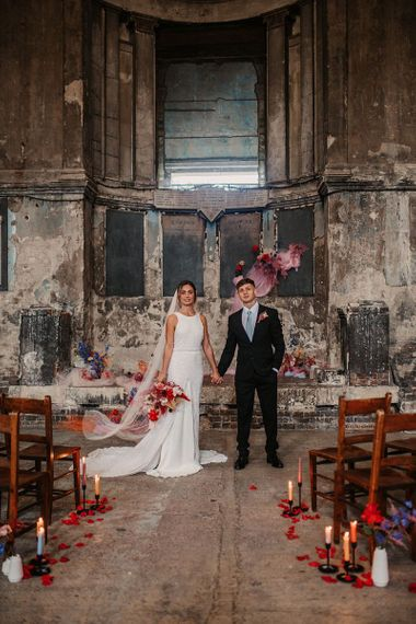 Bride and Groom Portrait at the Asylum Chapel with Pink Wedding Decor