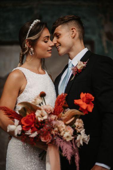 Stylish Bride in Sequin Dress, Pearl Headband and pink wedding jacket