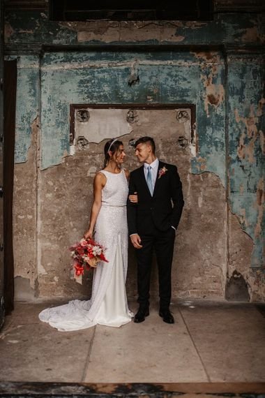 Stylish Bride and Groom in the Asylum Chapel with pink wedding jacket