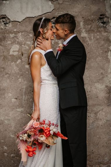 Groom Kissing His Bride in a Sequin Wedding Dress