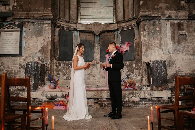 Bride and Groom Standing at the Altar of the Asylum Chapel