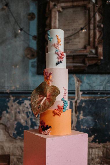 Five Tier Pink and Orange Wedding Cake with Anthurium Decor