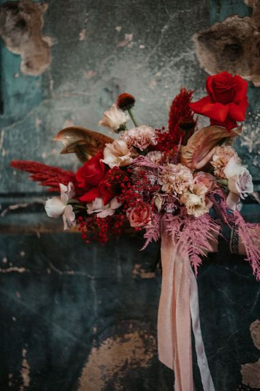 Pink and Red Wedding Bouquet Tied With Ribbon