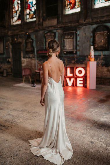 Bride in Low Back Satin Wedding Dress with Bridal Bun