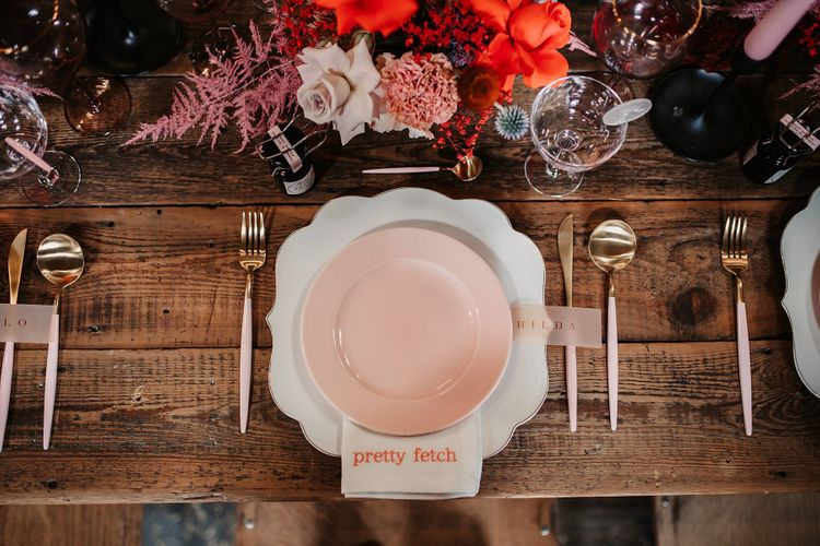 Place Setting with Ornate Charger Plate and Embroidered Napkin