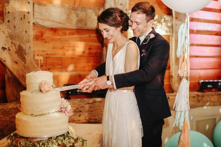 Cutting the Cake  // Homemade Country Wedding // Entertainment // Charlie Brear Bride // Pimhill Barn, Shrewsbury // Belle and Beau Fine Art Wedding Photography