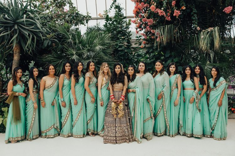 Bridal Party with Bride in Navy & Gold Saree and Bridesmaids in Mint Green Sarees