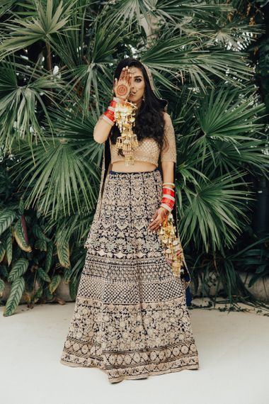 Indian Bride in Traditional Gold and Navy Saree