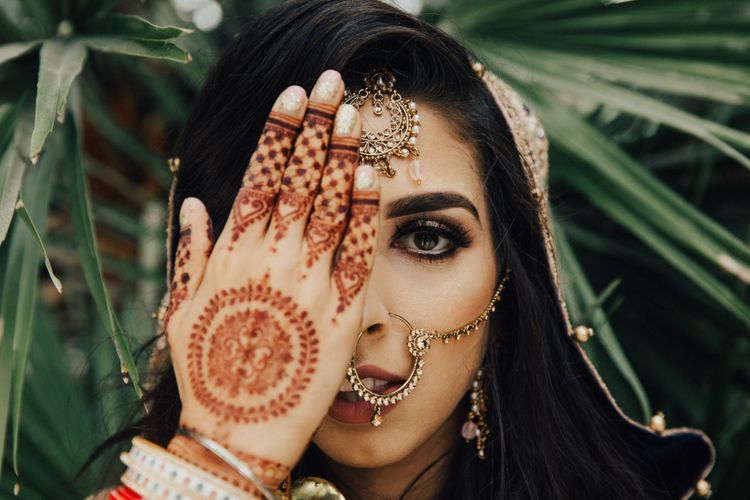 Indian Bride with Henna Hand Art and Bridal makeup