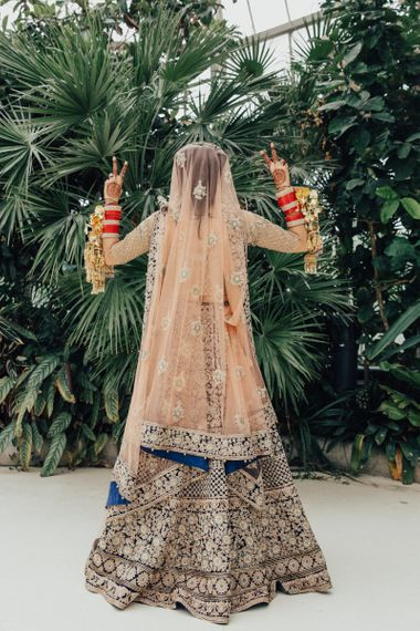 Bride in Navy and Gold Saree Wedding Dress