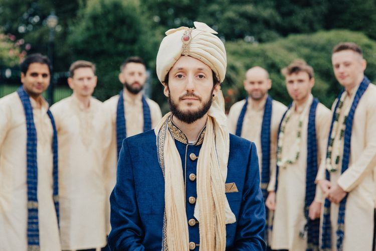 Groom in Navy and Gold Indian Wedding Suit with Turban