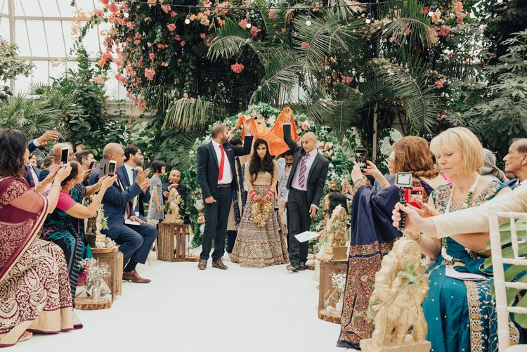 Indian Wedding Ceremony Bride Entrance Under a Canopy Held by Her Brothers