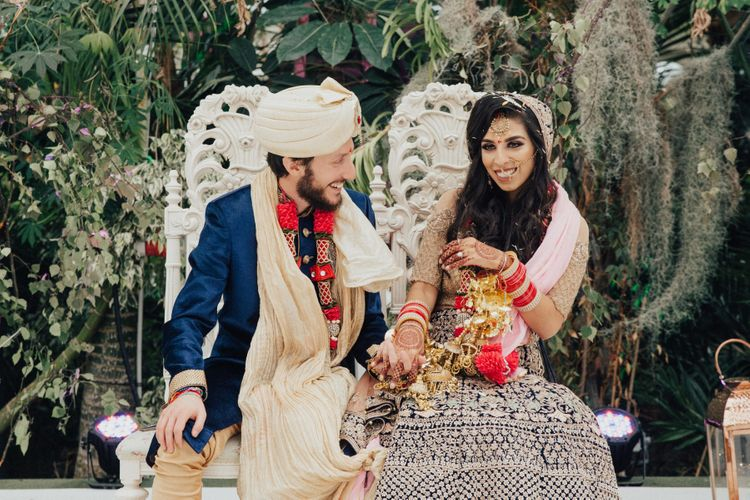 Bride in Navy and Gold Saree and Groom in Navy and Gold Suit with Turban
