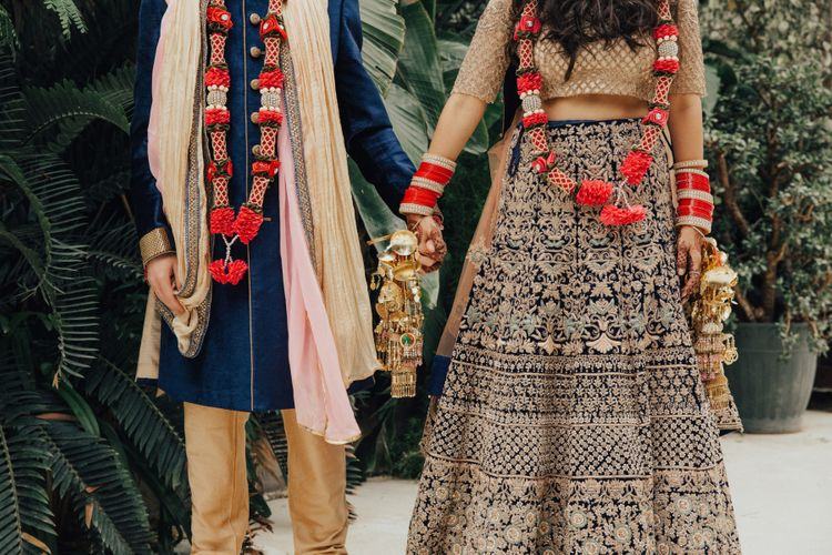 Bride and Groom Gold and Navy Traditional Hindu Wedding Attire