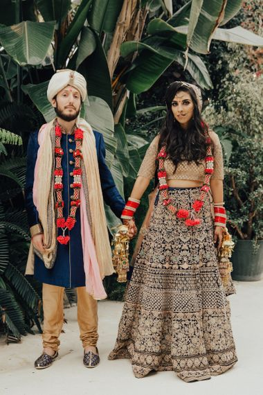 Bride and Groom in Gold and Navy Hindu Wedding Dress and Suit