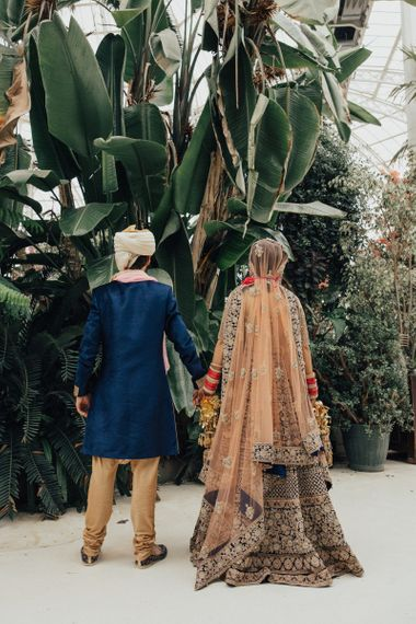 Bride and Groom in Navy and Gold Hindu Wedding Attire