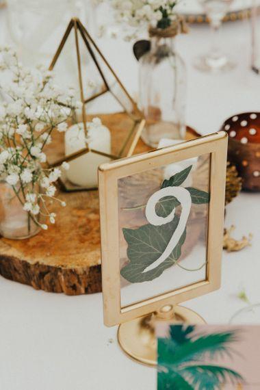 Gold Spray Painted Framed with Botanical Leaf Decor