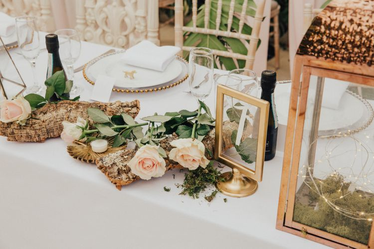 Top Table Wedding Decor with Tree Branch and Roses