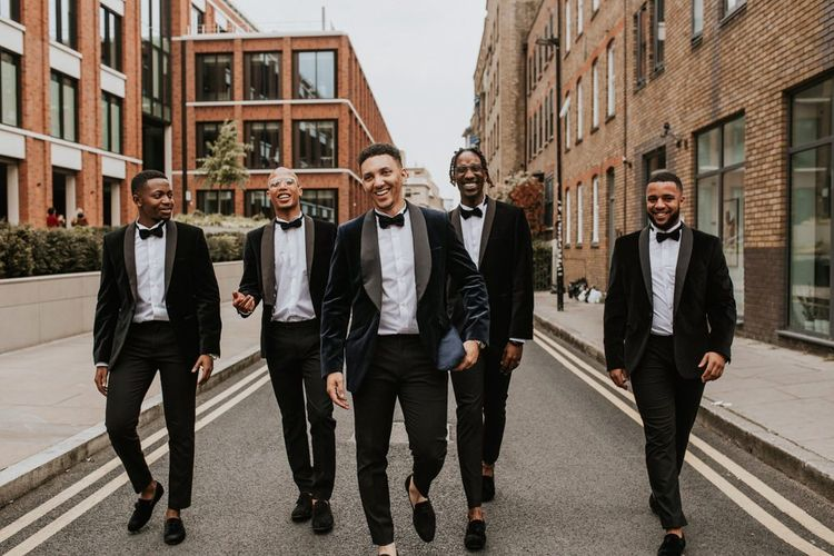 Stylish groomsmen in navy dinner jackets
