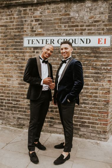 Groom and best man in navy velvet dinner jackets and bow ties