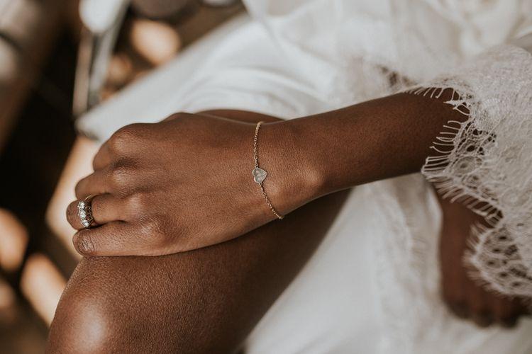 Black bride wearing a delicate heart bracelet
