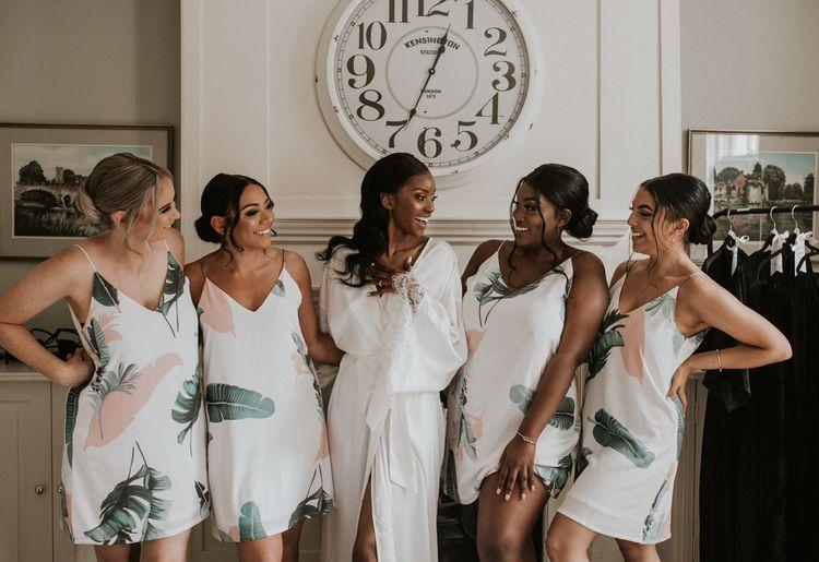 Wedding morning bridal party portrait in matching botanical slips