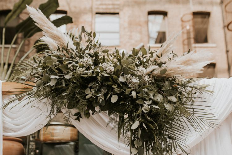 Green foliage and pampas grass wedding flowers