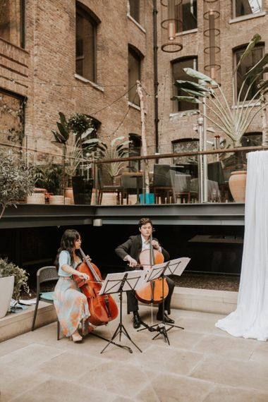 Musicians playing at Devonshire Terrance wedding ceremony