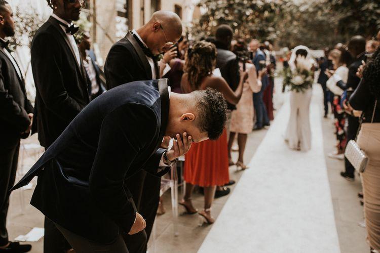 Emotional groom as his bride walks down the altar