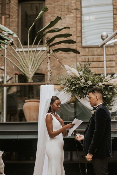 Emotional bride reading her vows at Devonshire Terrace wedding ceremony