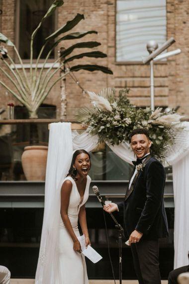 Happy bride and groom during rooftop wedding ceremony