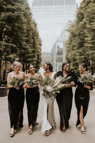 Bridesmaids in black velvet dresses for stylish Devonshire Terrace wedding