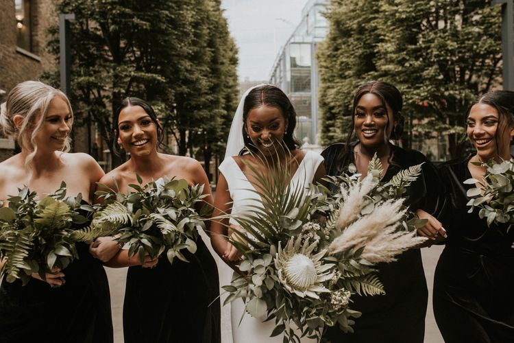 Happy bridal party portrait with King Protea, Pampas Grass and foliage wedding bouquets