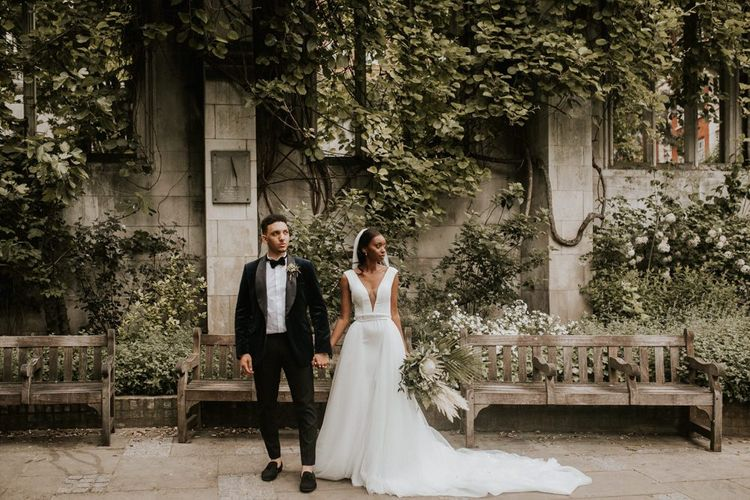 Stylish bride and groom in black-tie attire