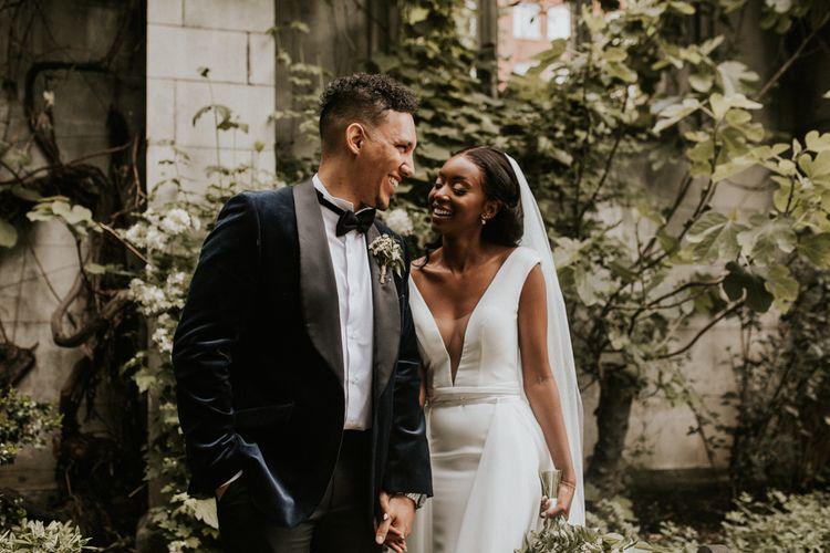 Elegant deep V front wedding dress and navy tuxedo jacket