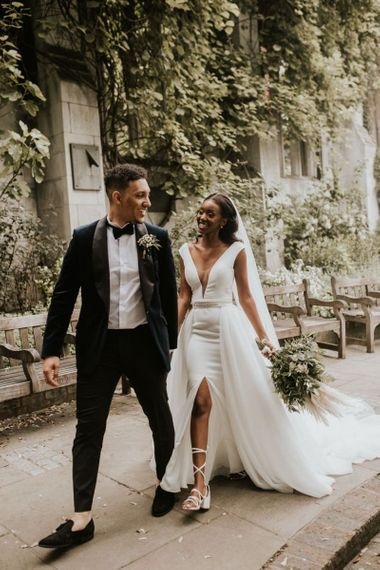 Black bride in front split wedding dress and lace up bridal shoes