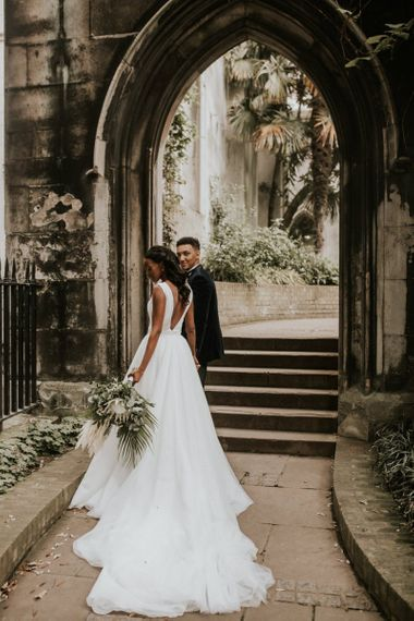 Black bride in Made With Love Bridal gown with detachable skirt
