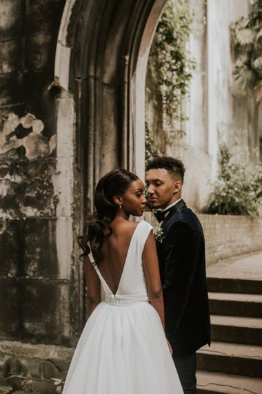 Black bride with backless wedding dress and long wavy hair