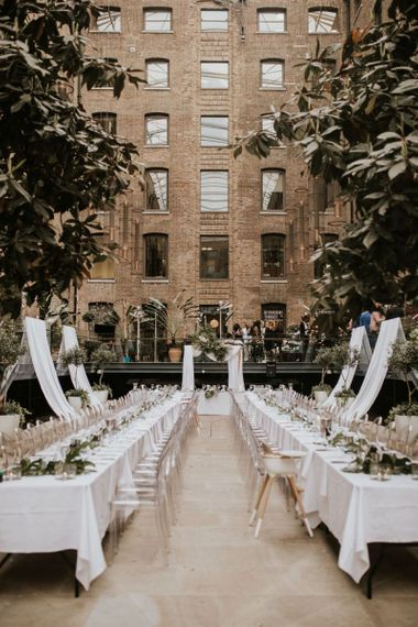 Devonshire Terrace wedding reception with drapes and ghost chairs