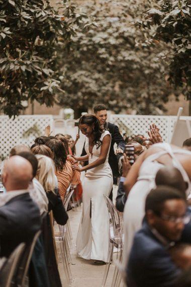 Bride and groom entering the Devonshire Terrace wedding breakfast