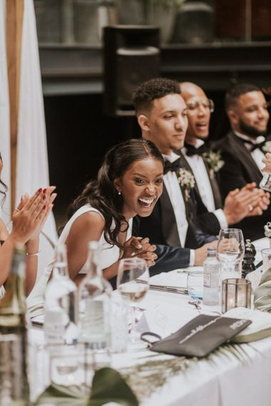 Bride laughing during the Devonshire Terrace wedding reception speeches