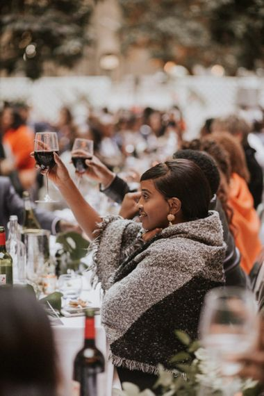 Wedding guests wrapped in blankets at Devonshire Terrace wedding reception