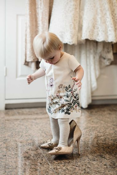 Flower Girl In Zara Baby Dress // Christmas Pub Wedding At The Falcon Rotherwick With Bride In Alice By Watters And Candle Lit Wedding Ceremony Images By Rebecca Searle Photography
