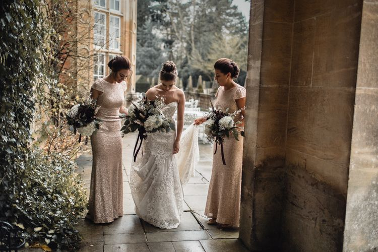 Bride & Bridesmaids In Winter Wedding Attire // Bride In Alice Dress By Watters // Christmas Pub Wedding At The Falcon Rotherwick With Bride In Alice By Watters And Candle Lit Wedding Ceremony Images By Rebecca Searle Photography